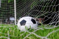Soccer football in Goal net Stock Images