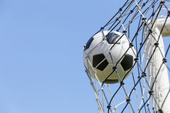 Soccer football in Goal net Stock Photography