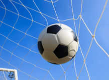 Soccer football in Goal net Stock Photo