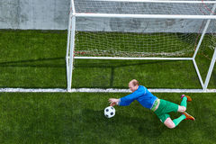 Soccer football goalkeeper making diving save Stock Images