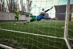 Soccer football goalkeeper making diving save Stock Photography