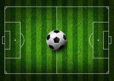 Soccer football on grass field Royalty Free Stock Photo