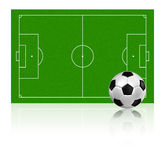 Soccer football on grass field Stock Photo