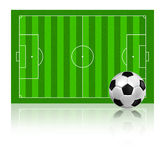 Soccer football on grass field Stock Images