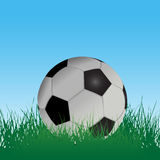 Soccer Football in Grass Field. A soccer football in grass on an athletic playing field under blue sky vector illustration