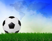 Soccer football on green field with blue sky background Royalty Free Stock Photos