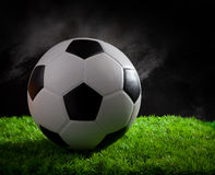 Soccer football on green grass field Stock Photography