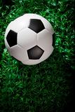 Soccer football on green grass field Royalty Free Stock Images