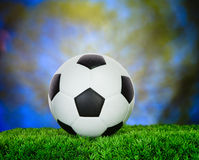 Soccer football on green grass field use for sport competition b Stock Photos