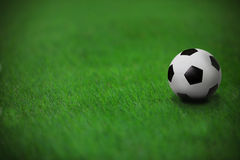 Soccer football on green grass in stadium Stock Images