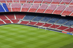 Soccer or football ground. Portion of football or soccer ground with seating in red and blue Stock Photography