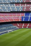 Soccer or football ground. Football or soccer ground with tall 4 tiers of seating in red and blue Royalty Free Stock Photo
