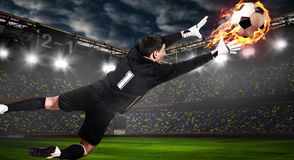 Soccer or football keeper catching ball. Soccer or football goalkeeper catching ball on stadium royalty free stock images