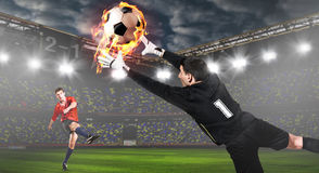 Soccer or football keeper catching ball royalty free stock images