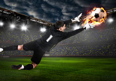 Soccer or football keeper catching ball. Soccer or football goalkeeper catching ball on stadium stock image