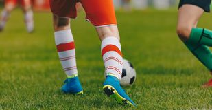 Soccer football kick-off in the stadium. Sporty player running and kicking a soccer ball stock photography