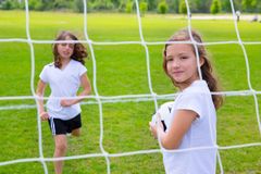 Soccer football kid girls playing on field Stock Photos