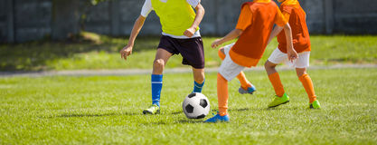 Soccer Football Match. Kids Playing Soccer. Young Boys Kicking Football Royalty Free Stock Photography