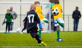 Soccer Football Match. Single Player Kick off. Kids Playing Soccer. Young Boys Kicking Football Ball. On the Sports Field. Kids Playing Soccer Tournament Game Royalty Free Stock Photography