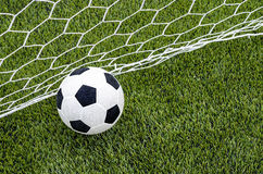 The soccer football with the net on the artificial green grass soccer field Stock Photography