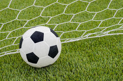 The soccer football with the net on the artificial green grass soccer field Royalty Free Stock Photos