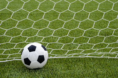 The soccer football with the net on the artificial green grass soccer field Royalty Free Stock Images