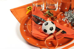 Soccer football party table in orange and white team colors Stock Photo
