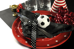 Soccer football party table red white and black team colors. Stock Photography