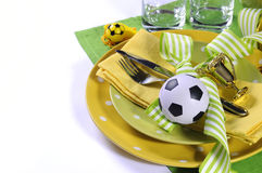Soccer football party table in yellow and green team colors Stock Photography
