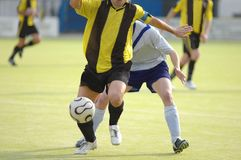 Soccer football player. Football soccer players trying to control the ball Stock Photography
