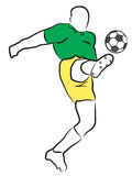 Soccer/Football Player. Soccer player kicking a ball Stock Image