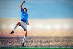 Soccer football player in blue team concept celebrating goal Royalty Free Stock Photography