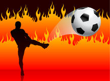 Soccer/Football Player on Hell Fire Background Royalty Free Stock Image