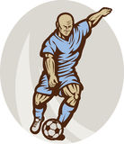 Soccer football player kicking Royalty Free Stock Images