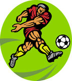 Soccer football player kicking Stock Images