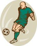 Soccer football player kicking Royalty Free Stock Photography