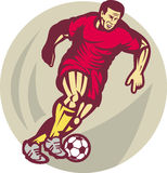Soccer football player kicking Stock Photo