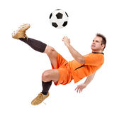 Soccer football player kicking the ball Stock Photos