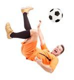 Soccer football player kicking the ball Royalty Free Stock Photos