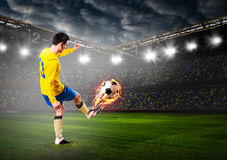 Soccer or football player. Is kicking ball on stadium Royalty Free Stock Photos