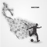 Soccer football player of a silhouette from particle. Background and text on a separate layer. color can be changed in one click Royalty Free Stock Image