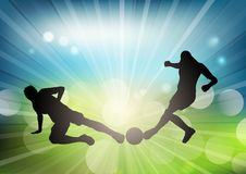Soccer or football player silhouettes on defocussed background. Soccer or football player silhouettes on a defocussed background Royalty Free Stock Photo