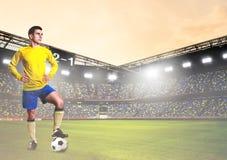 Soccer or football player on stadium. Soccer or football player is standing on stadium Royalty Free Stock Photo