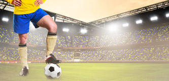 Soccer or football player on stadium Royalty Free Stock Image