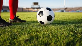 Soccer or football player standing with ball on the field for Ki royalty free stock image