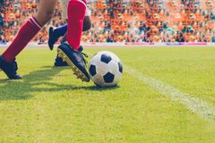 soccer or football player standing with ball on the field for Kick the soccer ball at football stadium,Soft focus stock photo