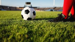 Soccer or football player standing with ball on the field for Ki royalty free stock images