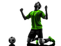 Soccer football player young happiness joy kneeling man silhouet. One soccer football player young man happiness joy kneeling in silhouette studio on white Royalty Free Stock Images