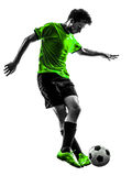 Soccer football player young man dribbling silhouette Stock Photos