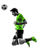 Soccer football player young man heading silhouette Stock Photos